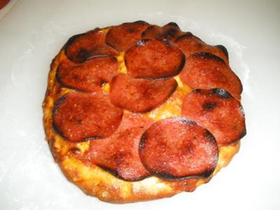 A Homemade Salami & Cheese Pizza